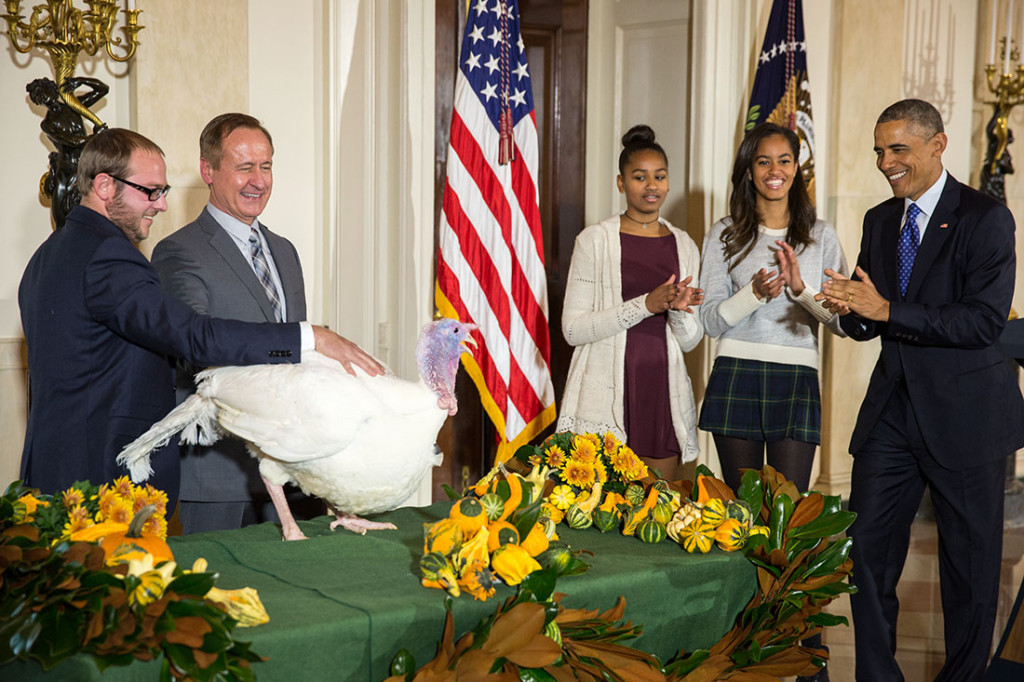 President Barack Obama, National Turkey Federation Chairman Gary Cooper; and son Cole Cooper participate in the annual National Thanksgiving Turkey pardon ceremony in the Grand Foyer of the White House, Nov. 26, 2014. (Official White House Photo by Chuck Kennedy)