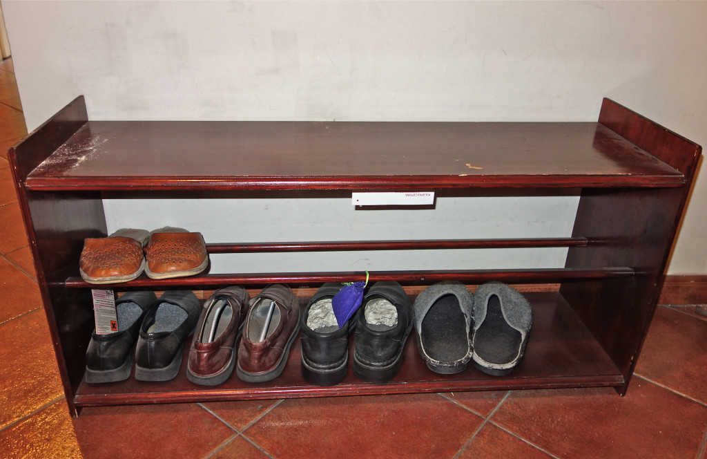 Czeslaw Milosz's, Nobel Lureat in Literaturte, apartment. Bench with poet's shoes and slippers.
